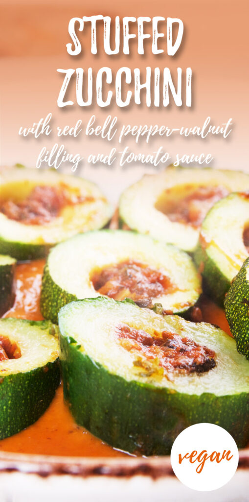 Stuffed zucchini with red bell pepper-walnut filling and tomato sauce