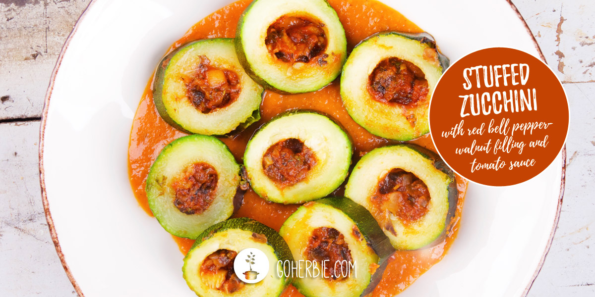 Zucchini with red bell pepper-walnut filling and tomato sauce