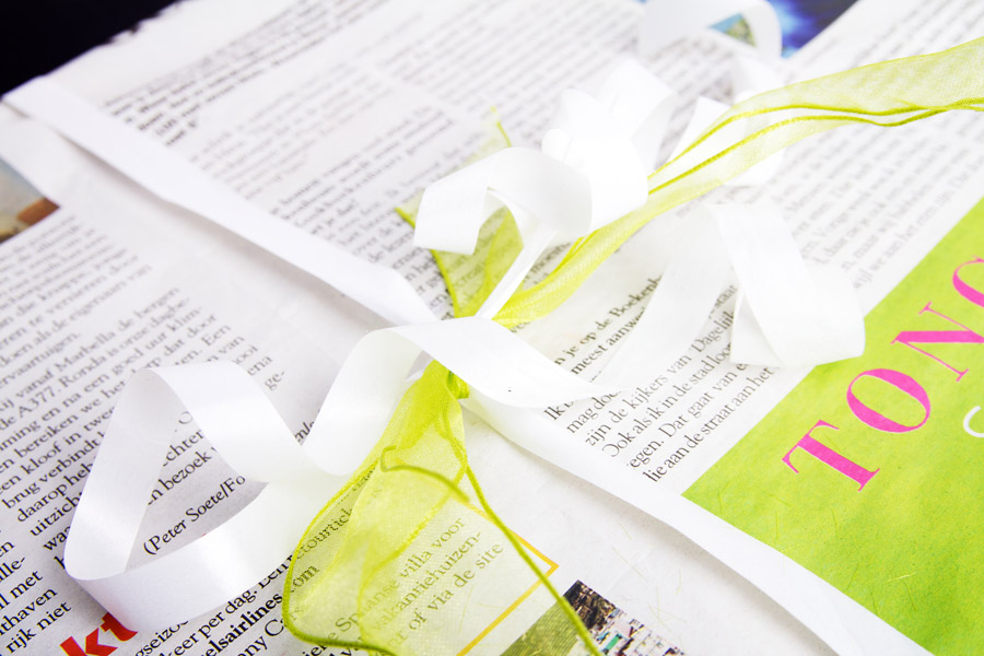 Wrap the gift in newspaper with matching bow
